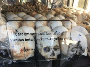 grusesome display of skulls at The Killing Fields in Phnom Penh Cambodia